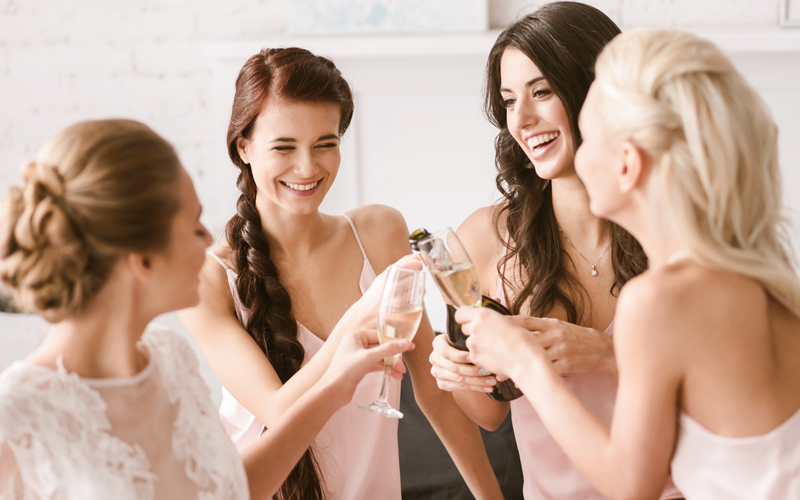 Joyful bride and bridesmaids